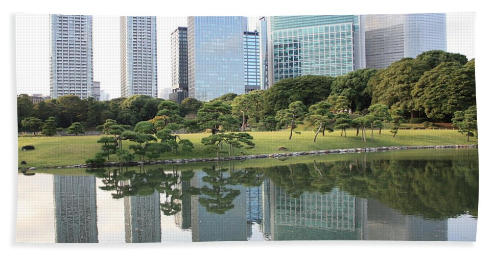 Tokyo Beach Towel featuring the photograph Tokyo Skyline Reflection by Carol Groenen