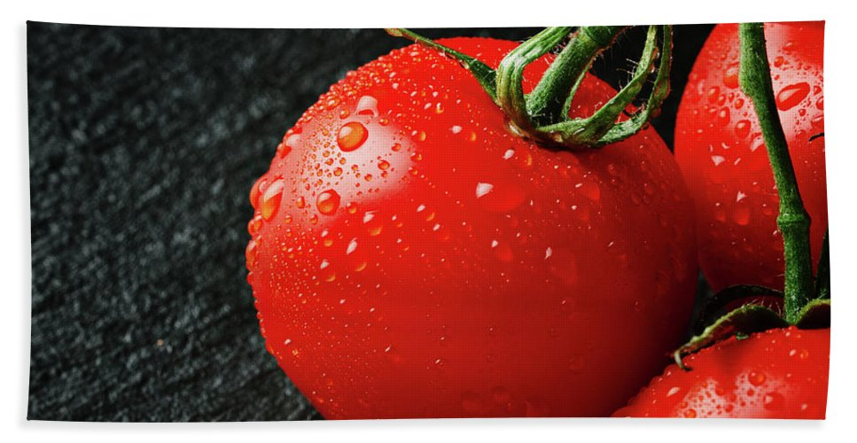 Background Beach Towel featuring the photograph Tomatoes Close Up On Black Slate by Tatiana Frank