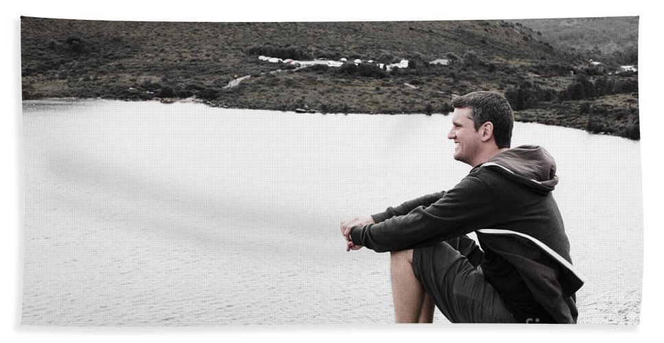 Man Beach Towel featuring the photograph Tourist Seated At Dove Lake Lookout In Tasmania by Jorgo Photography - Wall Art Gallery