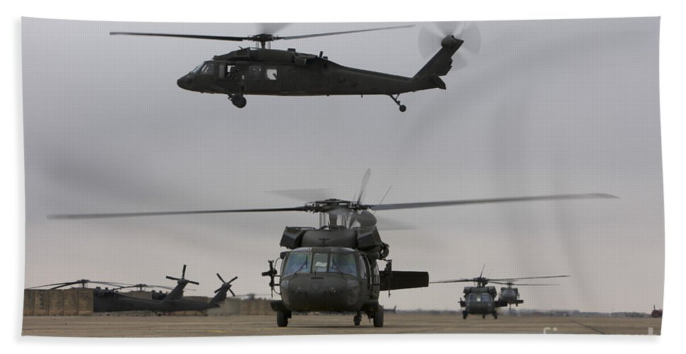 Aviation Beach Towel featuring the photograph Uh-60 Black Hawks Taxis by Terry Moore