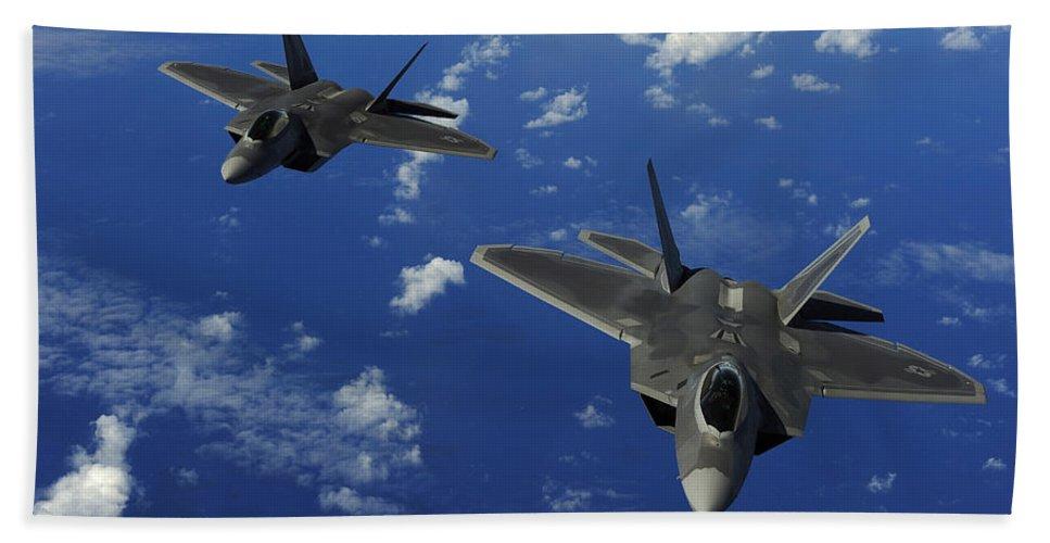 Guam Beach Towel featuring the photograph U.s. Air Force F-22 Raptors In Flight by Stocktrek Images
