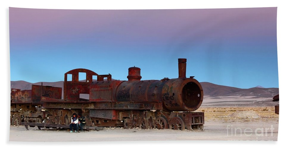 Steam Engine Beach Towel featuring the photograph Uyuni Train Cemetery At Sunset by James Brunker