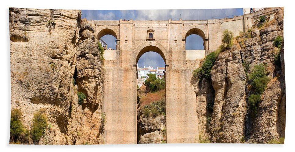Ronda Beach Towel featuring the photograph View Of The Tajo De Ronda And The Puente Nuevo Bridge From Across The Valley by Mal Bray