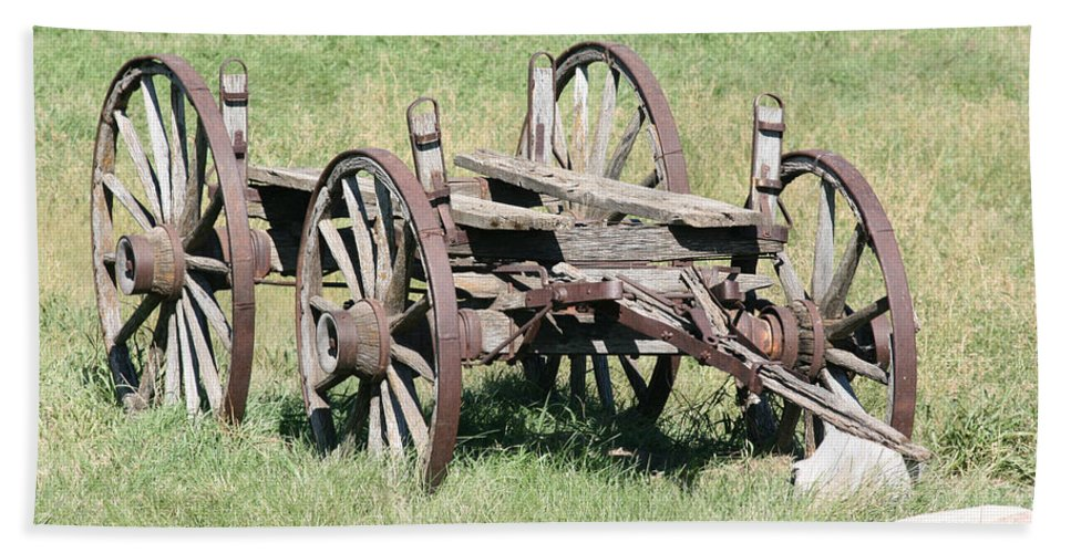 Old Wagon Ranch Horse Drawn Antique Wheels History Beach Towel featuring the photograph Wagon Aged by Andrea Lawrence