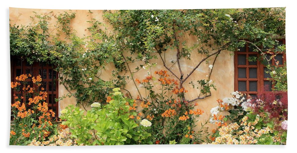 Carmel Mission Beach Towel featuring the photograph Warm Colors In Mission Garden by Carol Groenen