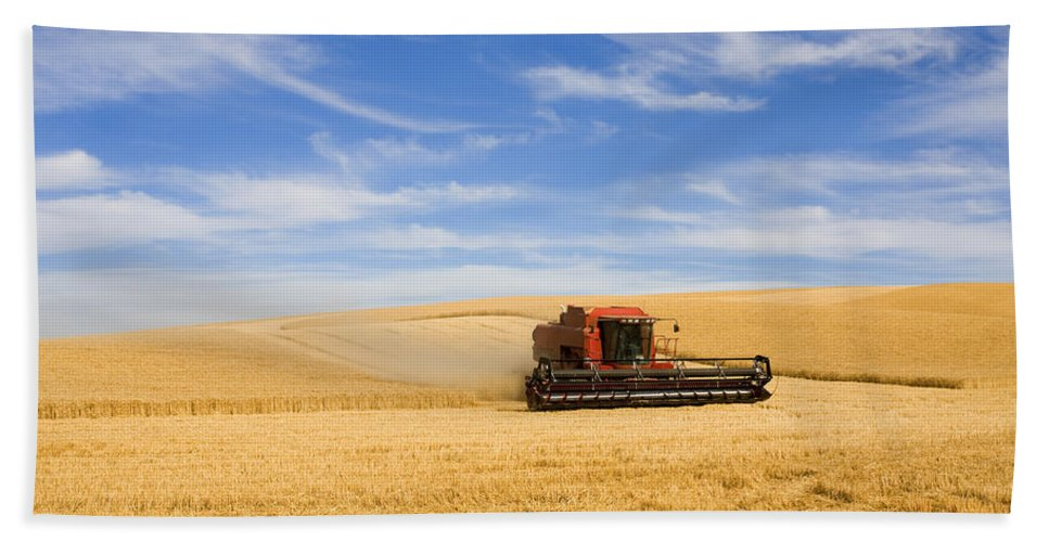 Combine Beach Towel featuring the photograph Wheat Harvest by Mike Dawson