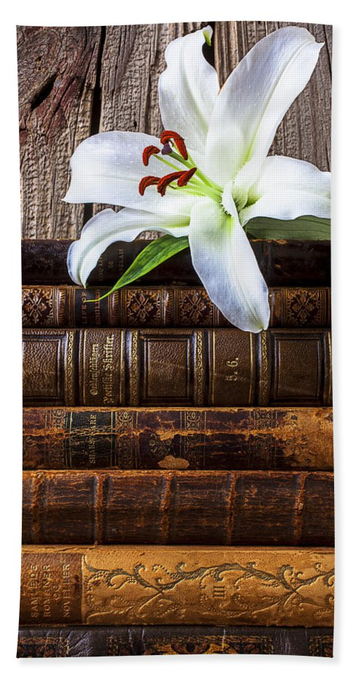White Lily Beach Towel featuring the photograph White Lily On Antique Books by Garry Gay