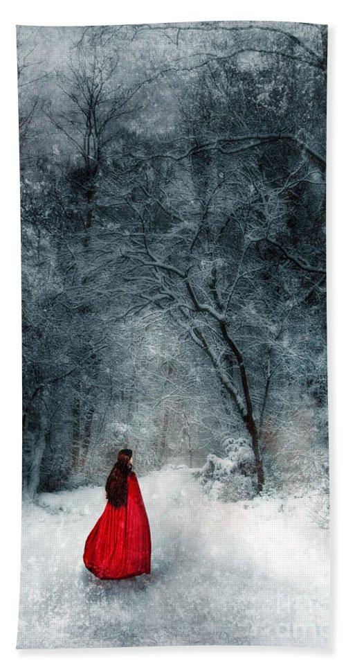 Walking Beach Towel featuring the photograph Woman In Red Cape Walking In Snowy Woods by Jill Battaglia