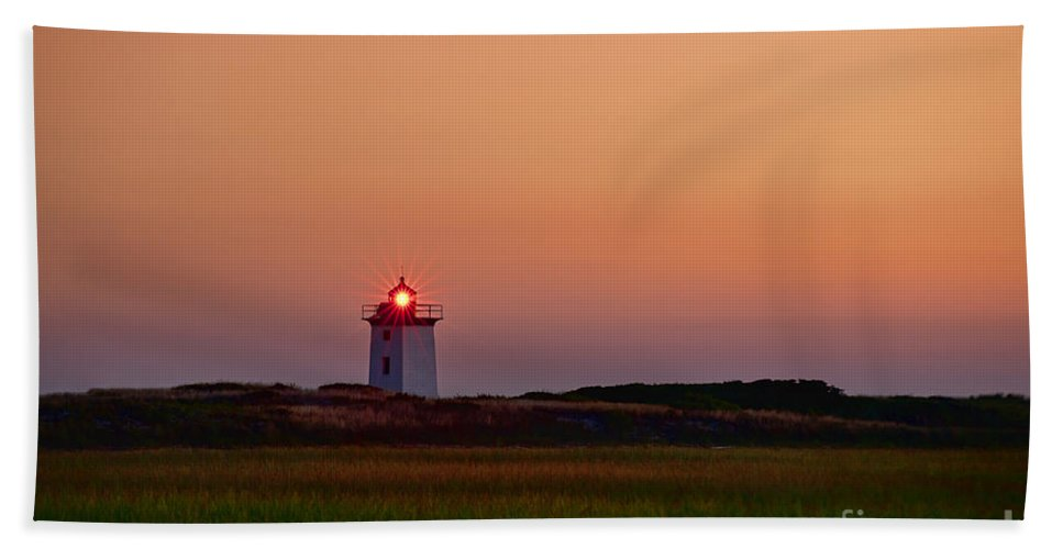 Cape Cod Beach Towel featuring the photograph Wood End Lighthouse Sunset by John Greim