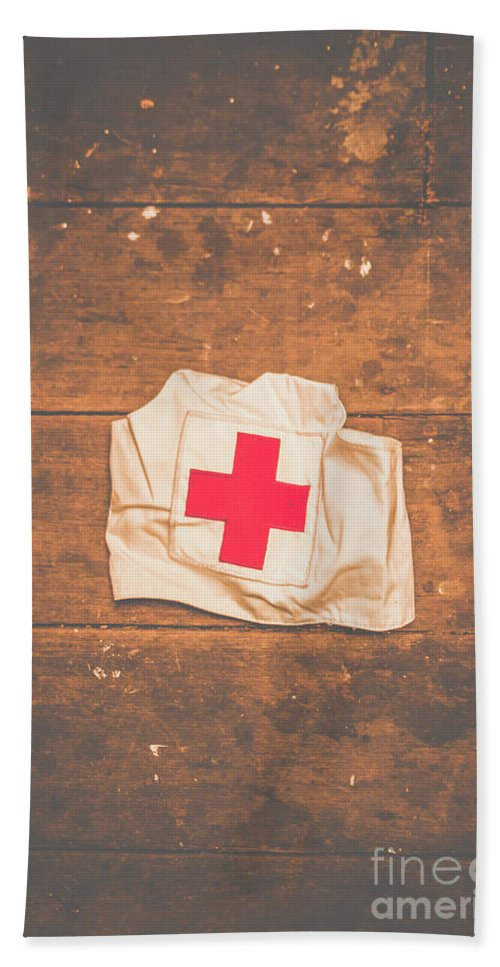 Nurse Beach Towel featuring the photograph Ww2 Nurse Cap Lying On Wooden Floor by Jorgo Photography - Wall Art Gallery