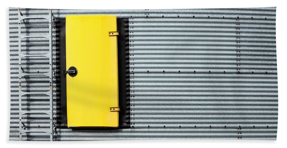 A Yellow Door And Ladder On On The Side Of A Galvanized Steel Industrial Storage Bin. Beach Towel featuring the photograph Yellow Door by Todd Klassy