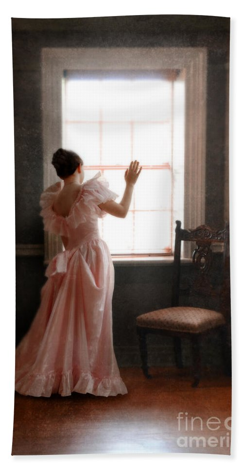 Girl Beach Towel featuring the photograph Young Lady In Pink Gown Looking Out Window by Jill Battaglia