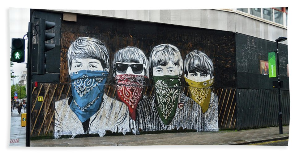 Bansky Beach Towel featuring the photograph Yhe Beatles wearing face masks street mural in London by RicardMN Photography
