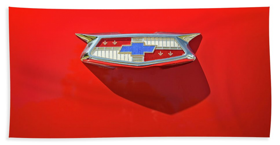 Vehicle Beach Towel featuring the photograph Chevrolet Emblem On A 55 Chevy Trunk by Scott Norris