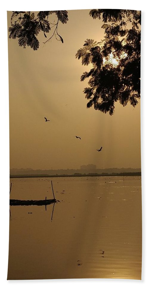 Sunset Beach Towel featuring the photograph Sunset by Priya Hazra