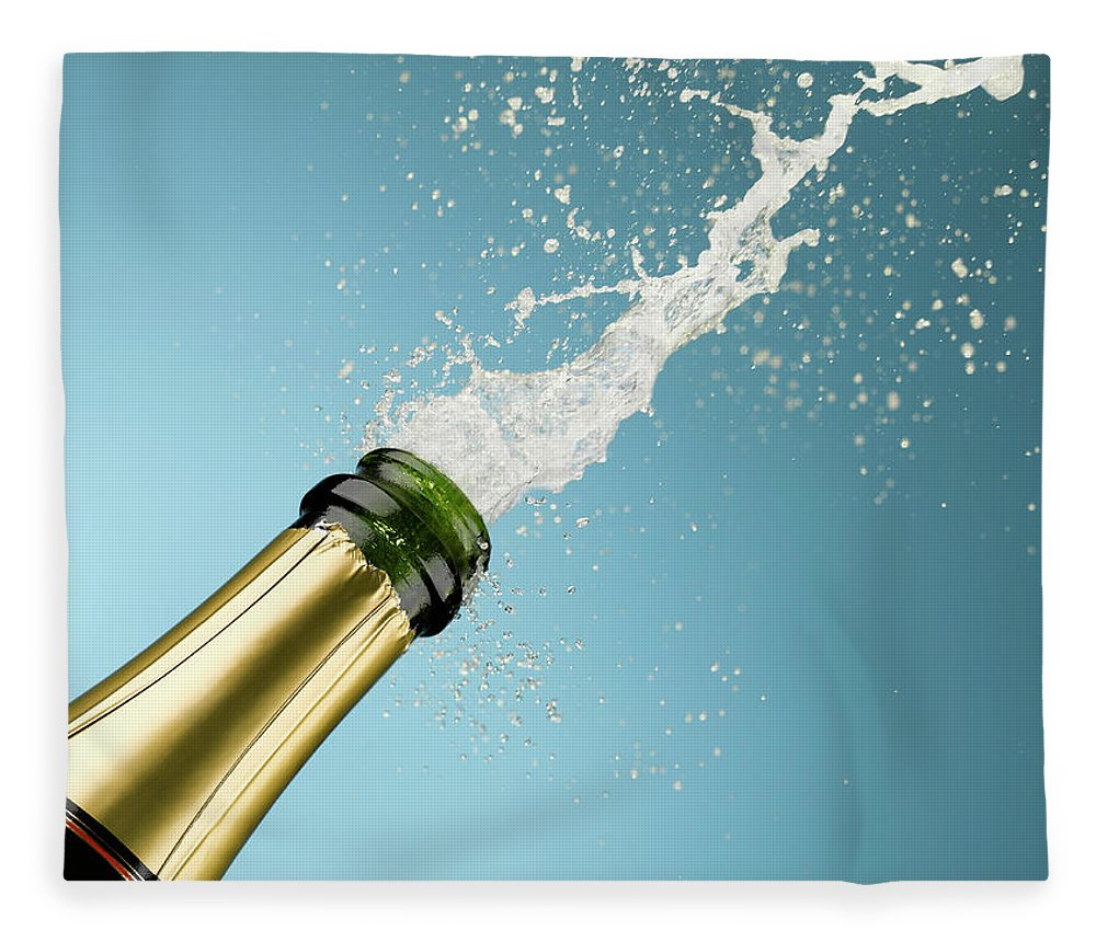 Celebration Fleece Blanket featuring the photograph Champagne Exploding From Bottle by Andy Roberts