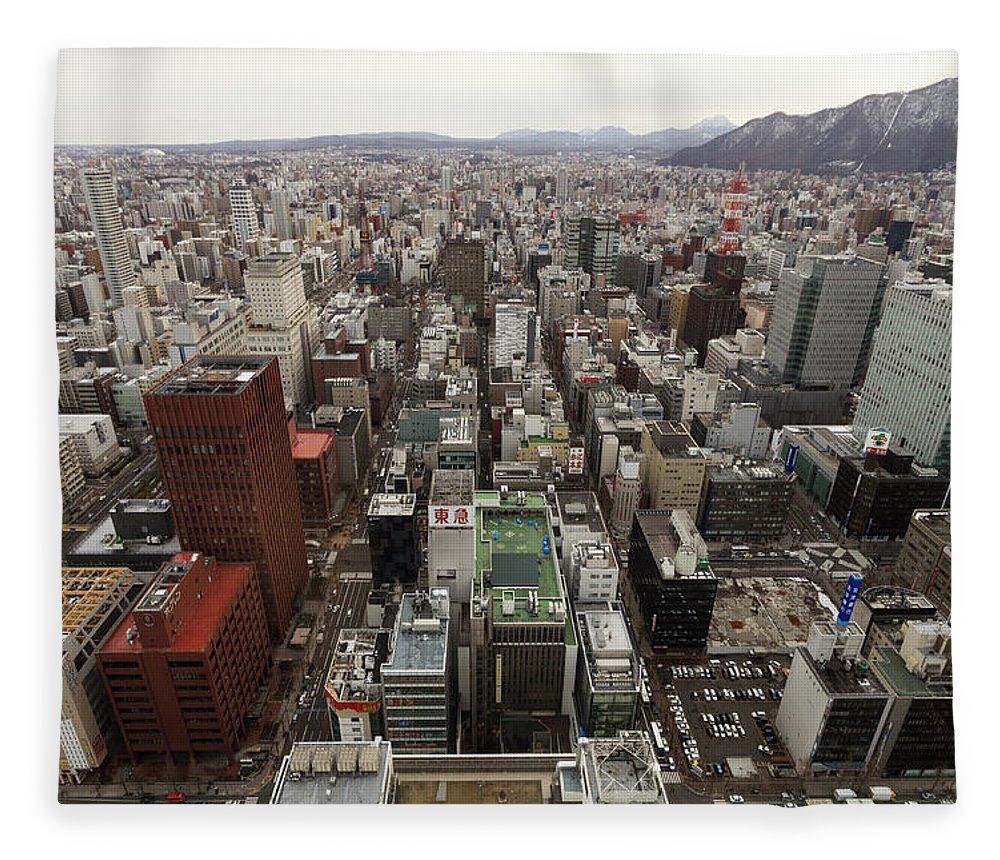 Hokkaido Fleece Blanket featuring the photograph Cityscape Of Sapporo, Hokkaido, Japan by Tetsuya Aoki