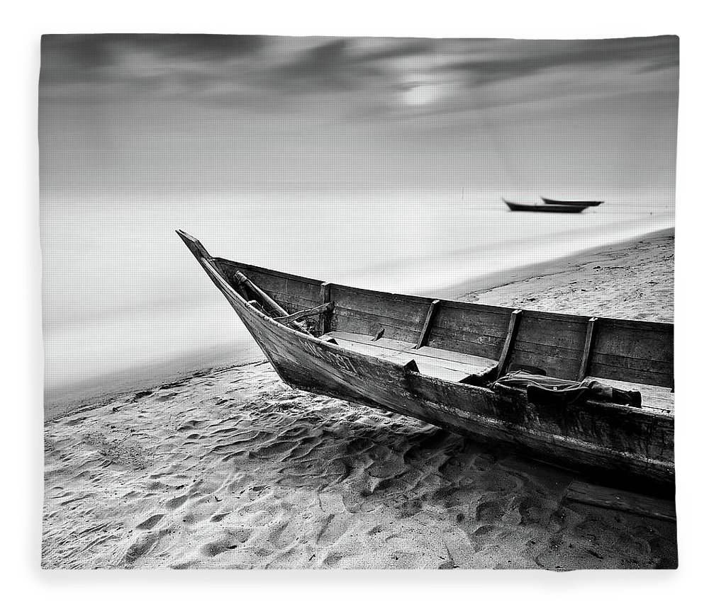 Tranquility Fleece Blanket featuring the photograph Fisherman Boat At Beach In Black And by Photography By Azrudin