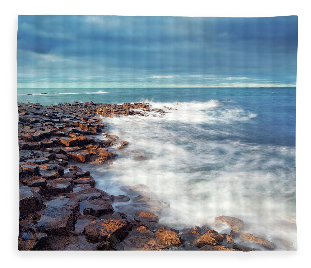 Water's Edge Fleece Blanket featuring the photograph Giants Causeway On A Cloudy Day by Mammuth