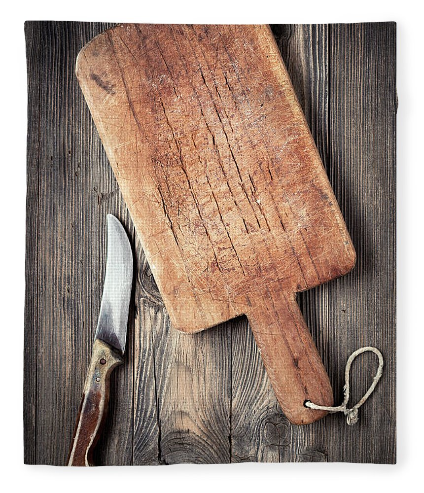 Empty Fleece Blanket featuring the photograph Old Cutting Board And Knife by Barcin