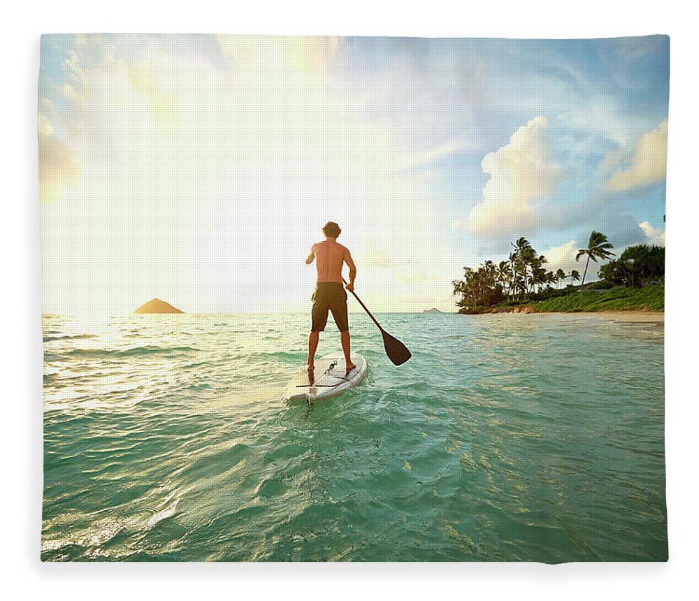 Tranquility Fleece Blanket featuring the photograph Caucasian Man On Paddle Board In Ocean by Colin Anderson Productions Pty Ltd