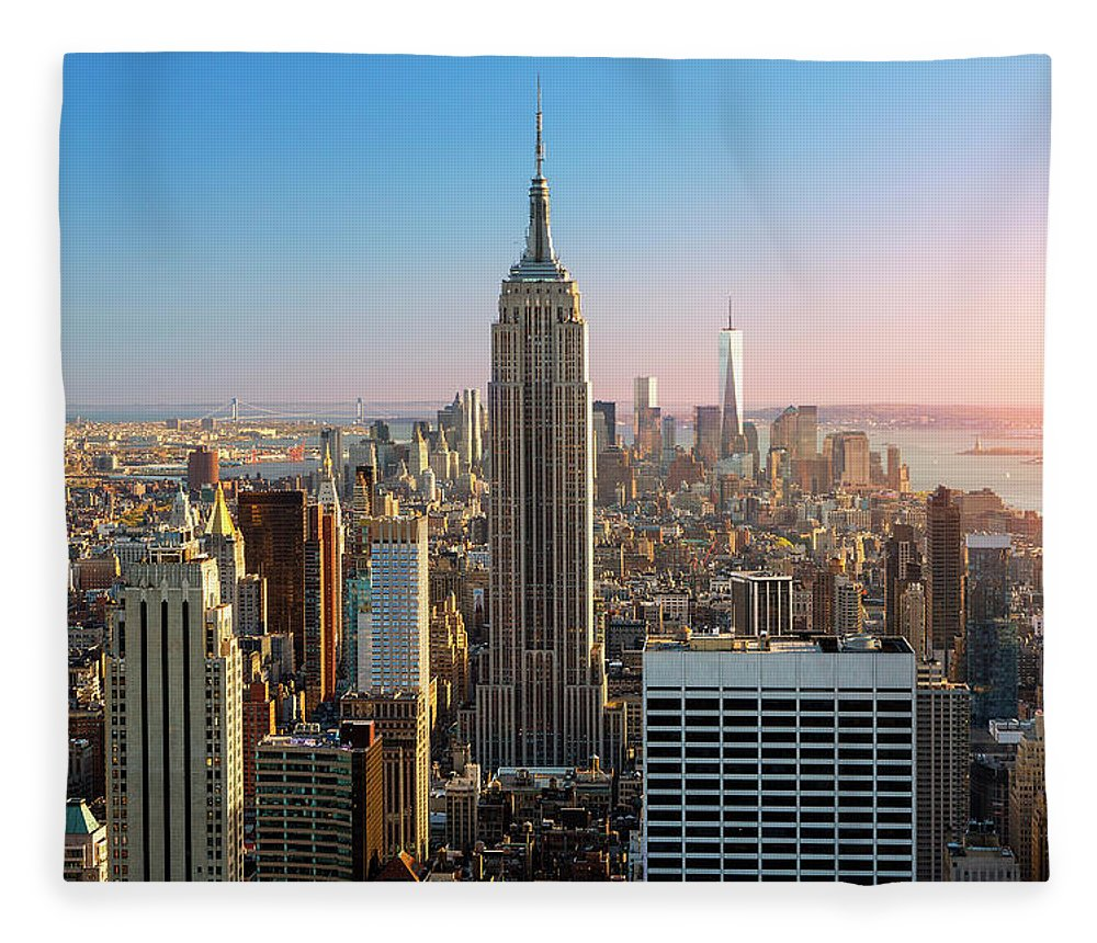 Tranquility Fleece Blanket featuring the photograph Empire State Building At Sunset by Sylvain Sonnet