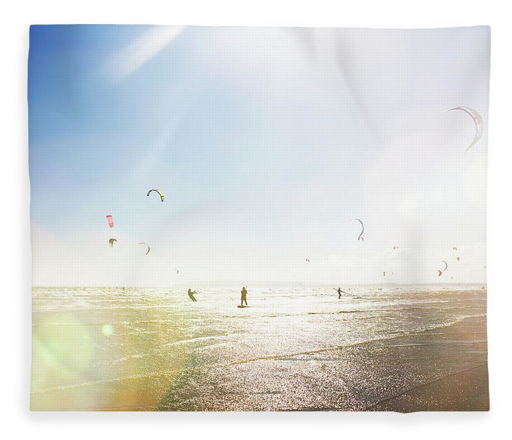 Water's Edge Fleece Blanket featuring the photograph Kite Surfers by Nick David
