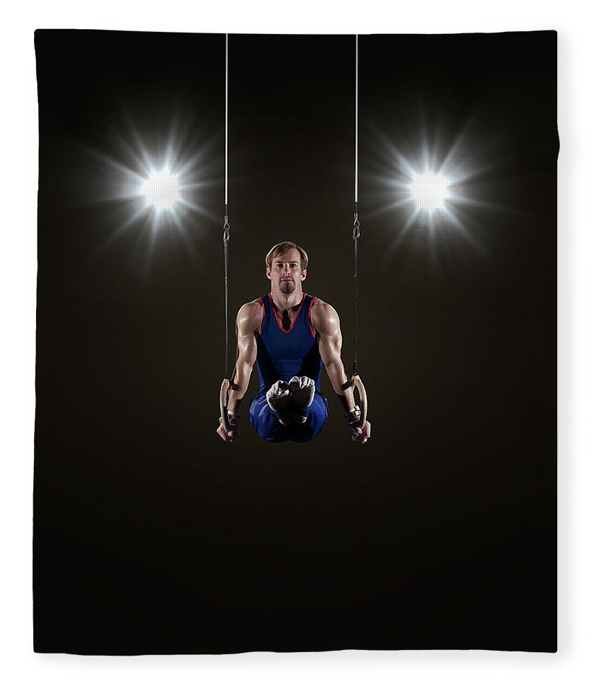 Expertise Fleece Blanket featuring the photograph Male Gymnast On Rings by Mike Harrington