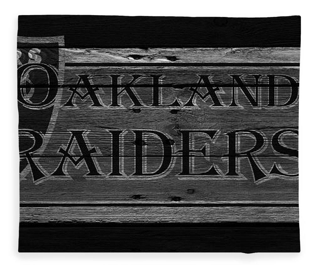 Raiders Fleece Blanket featuring the photograph Oakland Raiders by Joe Hamilton