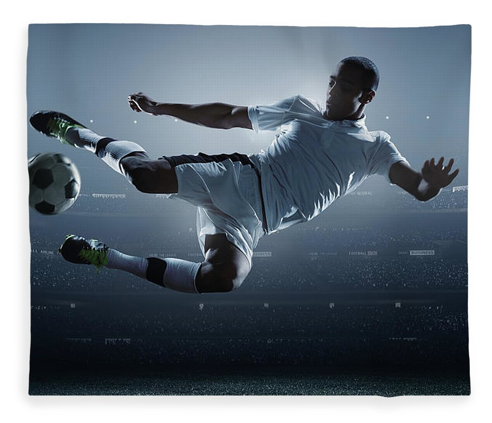 Goal Fleece Blanket featuring the photograph Soccer Player Kicking Ball In Stadium by Dmytro Aksonov