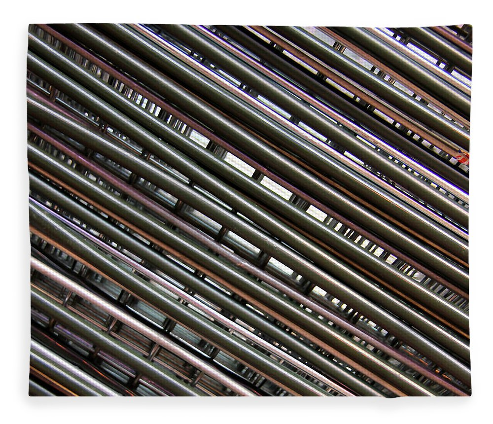 In A Row Fleece Blanket featuring the photograph Abstract View Of Shopping Baskets by Andrea Kennard Photography