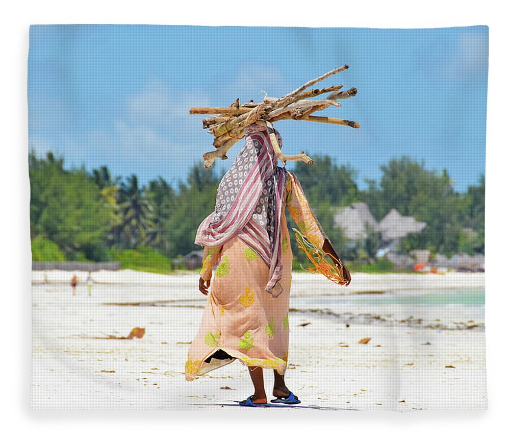People Fleece Blanket featuring the photograph African Girl With A Bundle Of Reeds On by Volanthevist