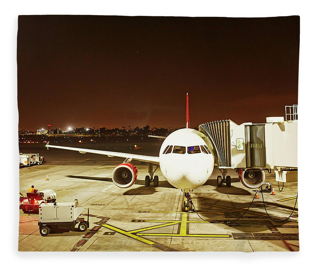 Passenger Boarding Bridge Fleece Blanket featuring the photograph Airplane Parked At Jetway by Ballyscanlon