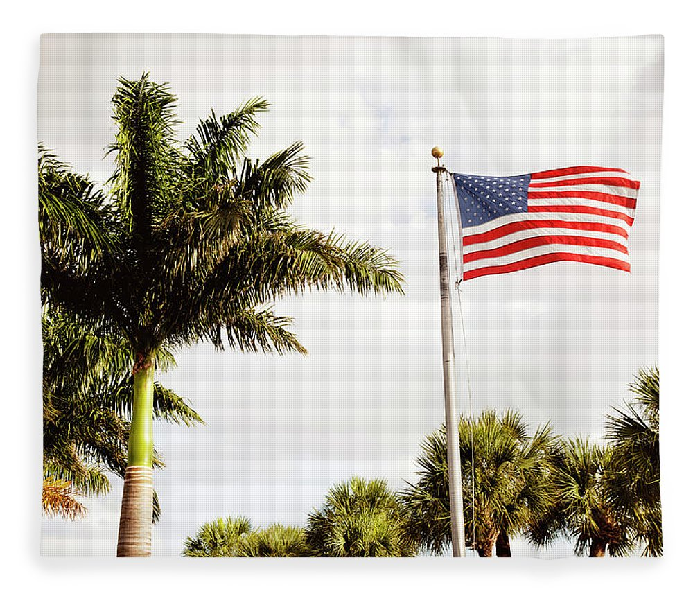 Tranquility Fleece Blanket featuring the photograph American Flag Flying Amongst Palm Trees by Ron Levine