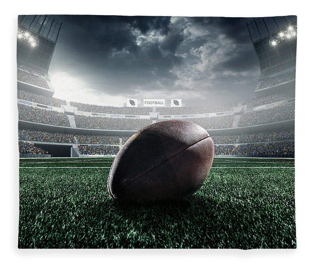 Event Fleece Blanket featuring the photograph American Football Ball by Dmytro Aksonov