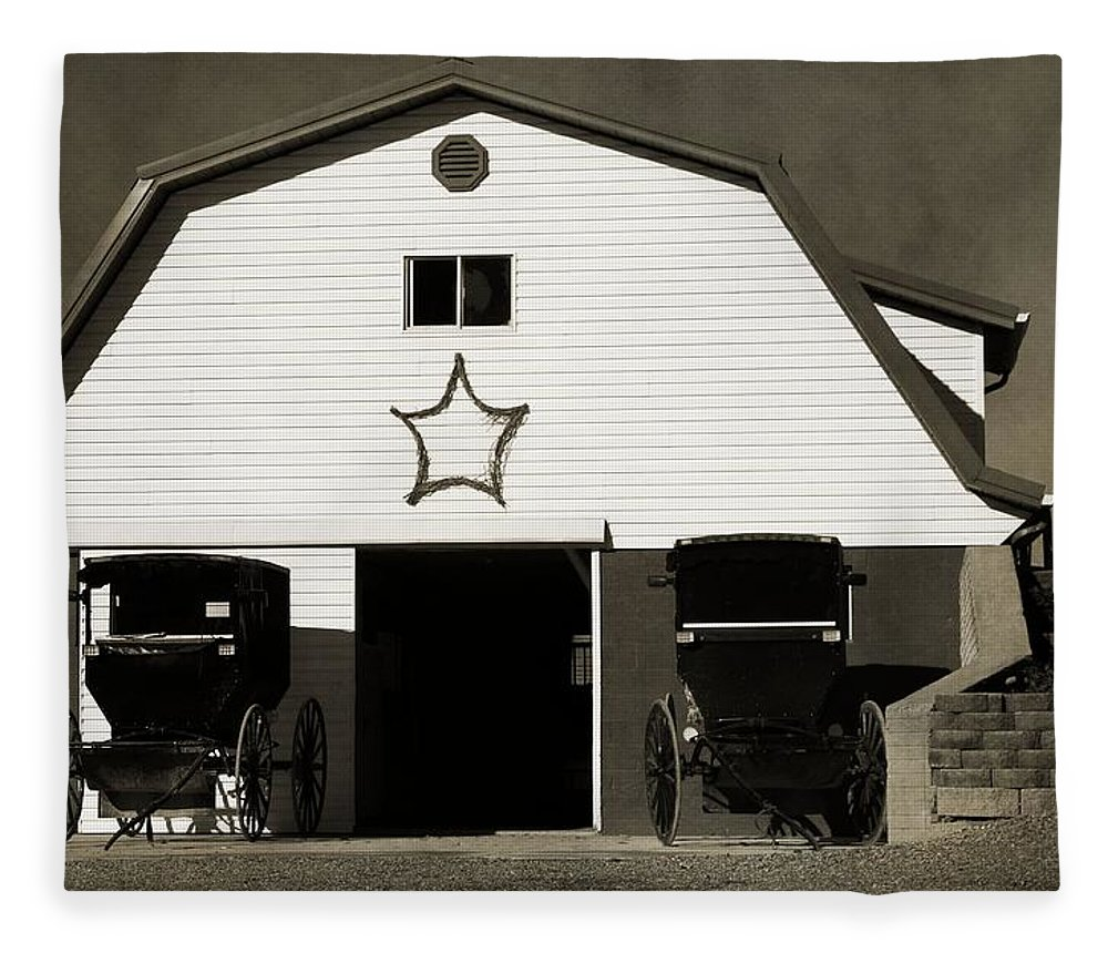 Black And White Amish Buggies And Barn Fleece Blanket featuring the photograph Amish Barn And Buggies by Dan Sproul