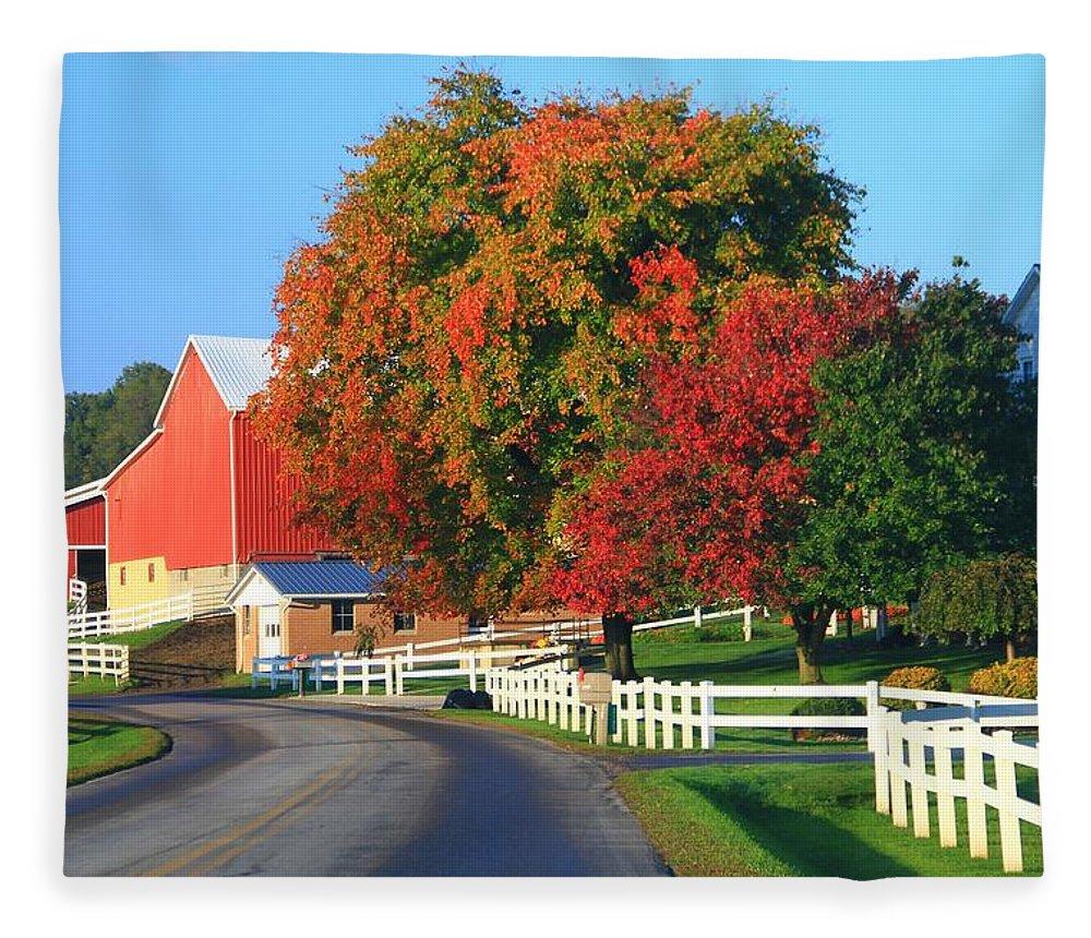 Amish Barn In Autumn Fleece Blanket featuring the photograph Amish Barn In Autumn by Dan Sproul