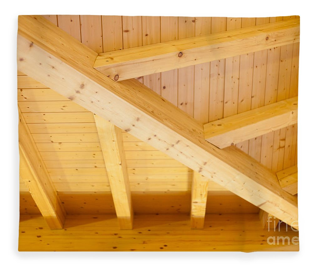 Angled Fleece Blanket featuring the photograph Architectural Detail Of An Indoor Wooden Ceiling by Stephan Pietzko