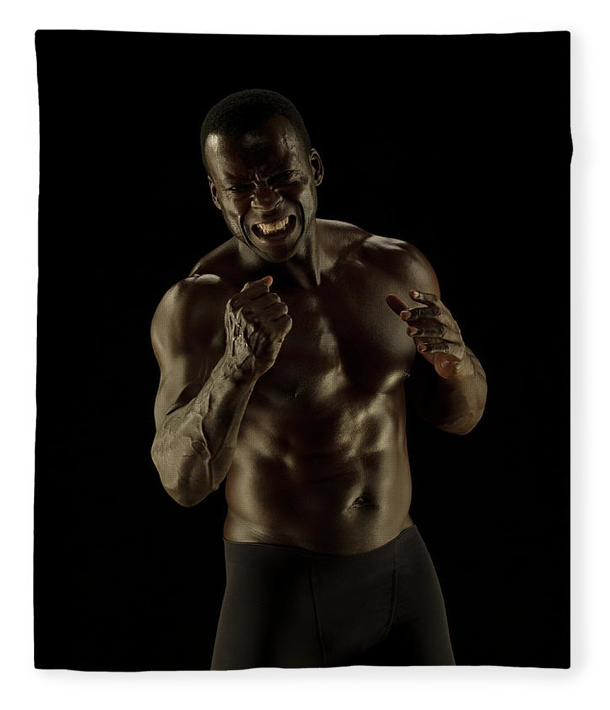Toughness Fleece Blanket featuring the photograph Athletic Female, Angry Shout, Clenched by Jonathan Knowles