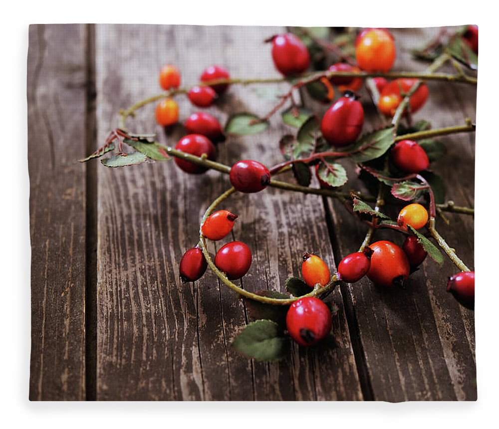 Event Fleece Blanket featuring the photograph Autumn Decoration With Rose Hips by Moncherie