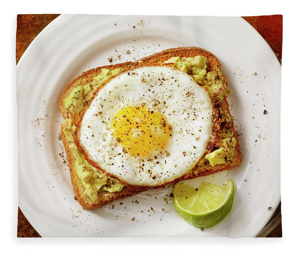 Breakfast Fleece Blanket featuring the photograph Avocado Toast With A Fried Egg by Lauripatterson