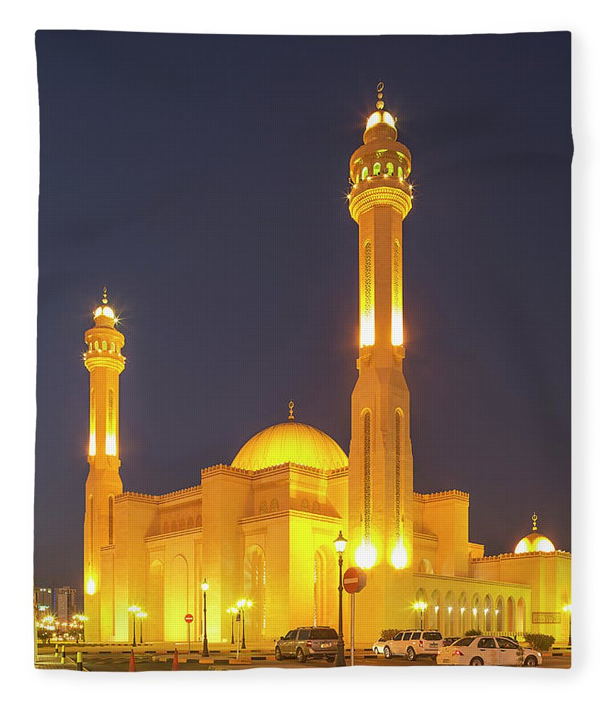 Tranquility Fleece Blanket featuring the photograph Bahrain. Manama. The Al Fateh Grand by Buena Vista Images