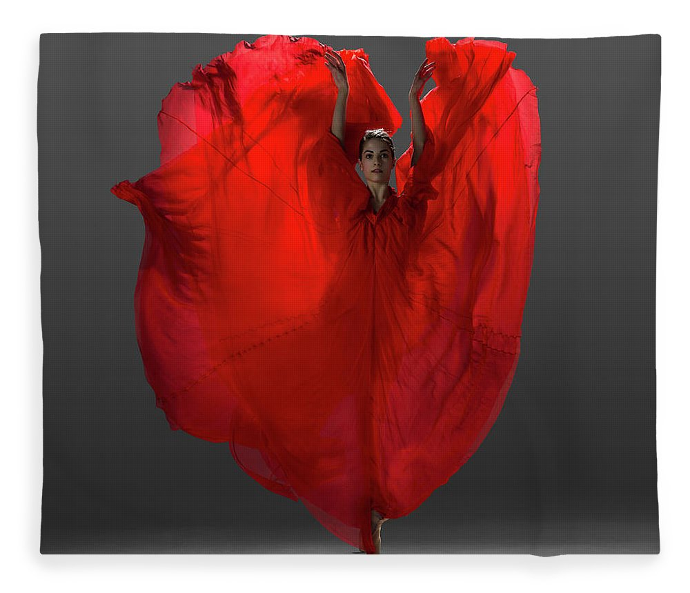 Ballet Dancer Fleece Blanket featuring the photograph Ballerina On Pointe With Red Dress by Nisian Hughes