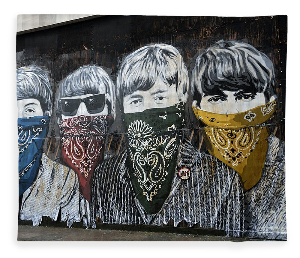 Banksy Fleece Blanket featuring the photograph The Beatles wearing face masks street mural by RicardMN Photography