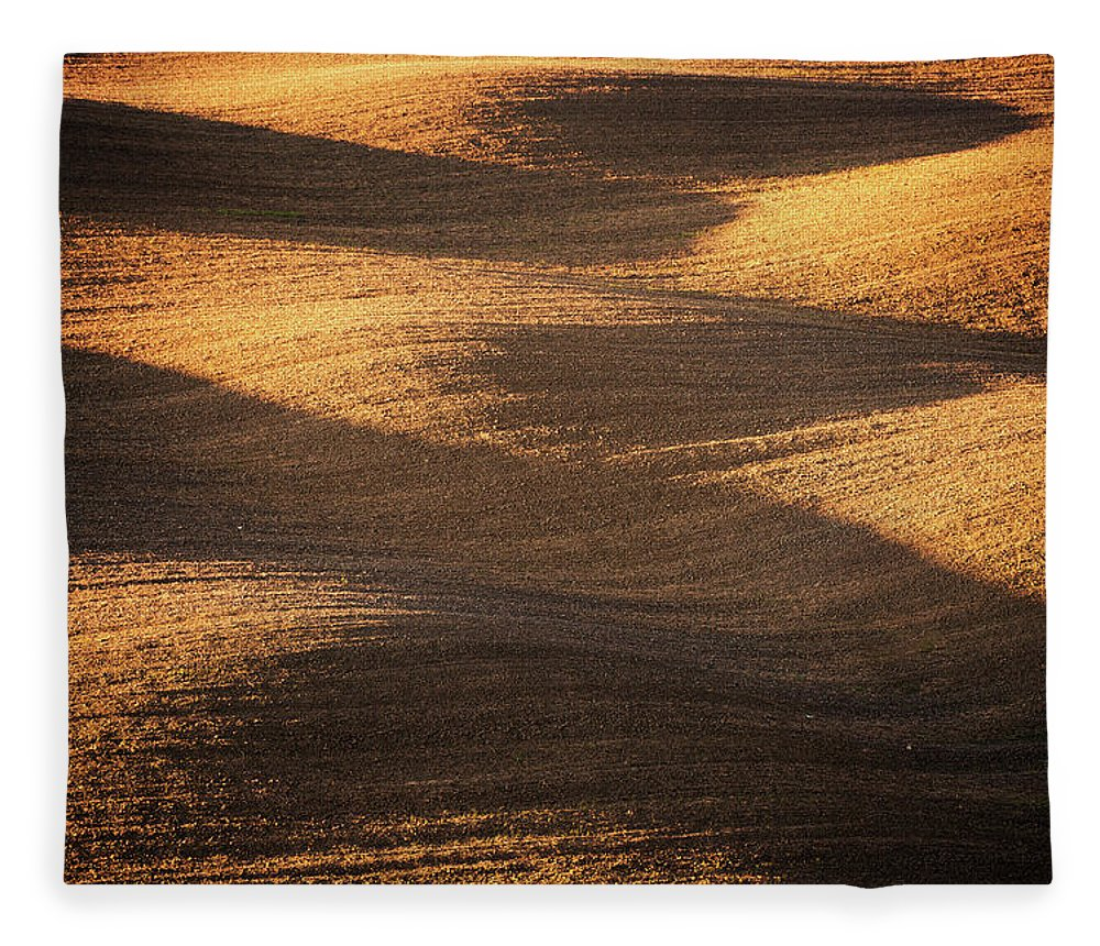 Tranquility Fleece Blanket featuring the photograph Bronze Waves by Philipp Klinger
