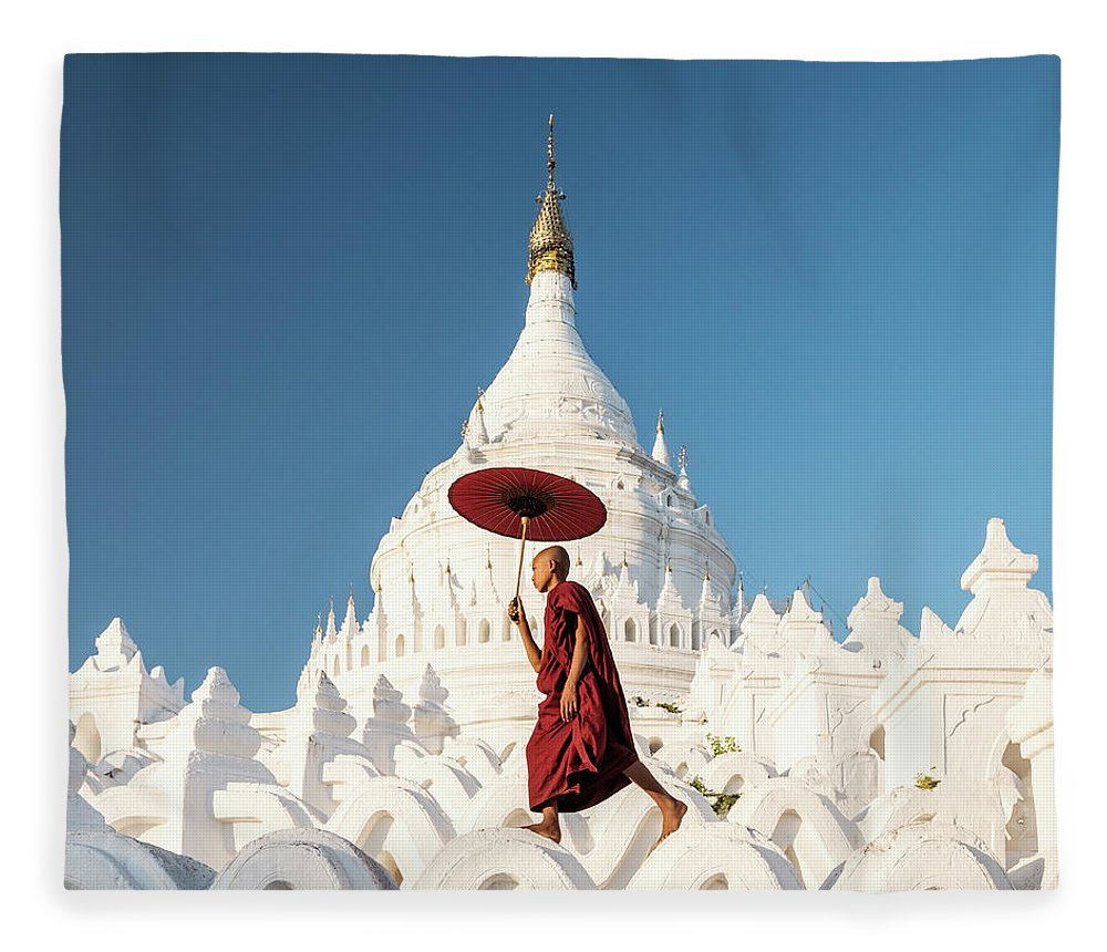 Pagoda Fleece Blanket featuring the photograph Buddhist Monk Walking Across Arches Of by Martin Puddy