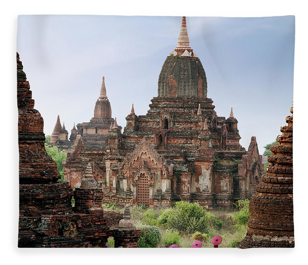 Tranquility Fleece Blanket featuring the photograph Buddhist Monks Walking Past Temple by Martin Puddy