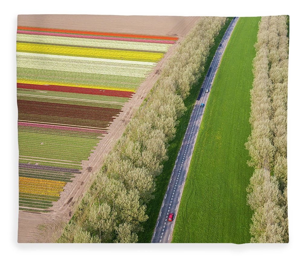 Scenics Fleece Blanket featuring the photograph Car On Road Near Tulip Fields, Holland by Peter Adams