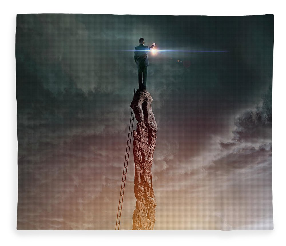 Corporate Business Fleece Blanket featuring the photograph Caucasian Man With Lantern On Rocky by Colin Anderson Productions Pty Ltd