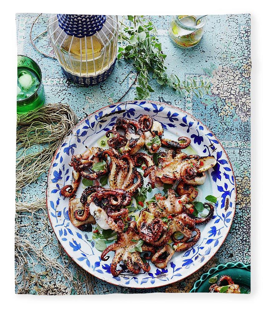 Temptation Fleece Blanket featuring the photograph Chargrilled Lemon Oregano Octopus by Brett Stevens